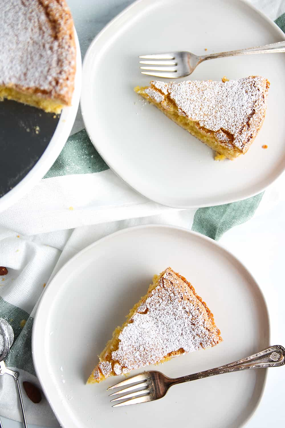 Plated slices of Galician Almond Tart dusted with powdered sugar