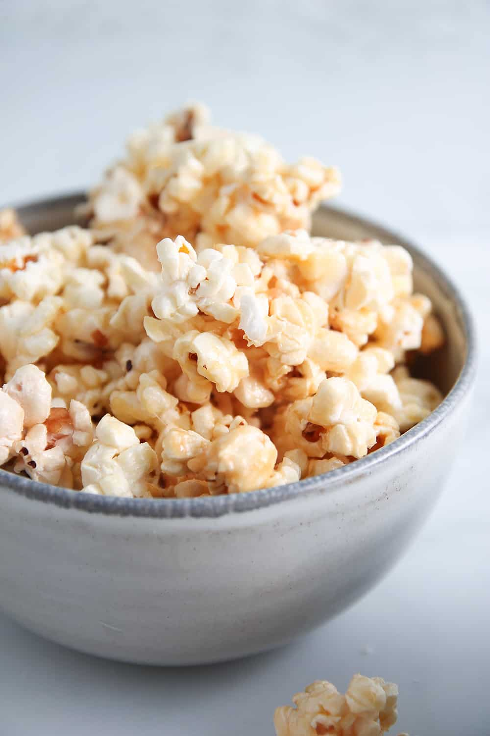Close up of a bowl filled with microwave caramel corn