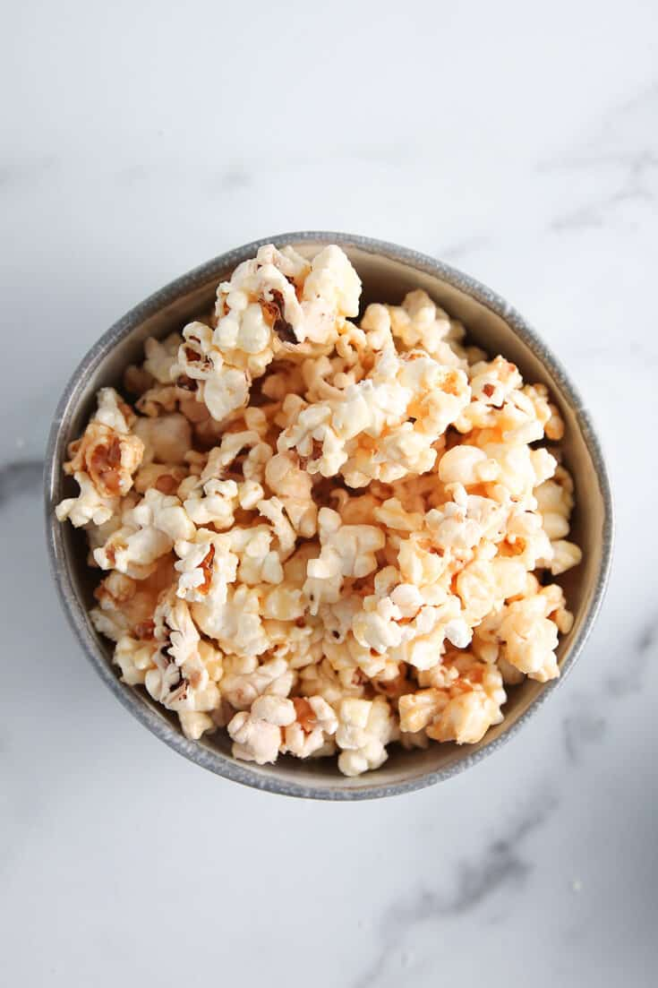 Microwave Caramel Corn is fast and easy to make. You'll be curled up on the couch with a bowl of caramel corn before you know it with this recipe!