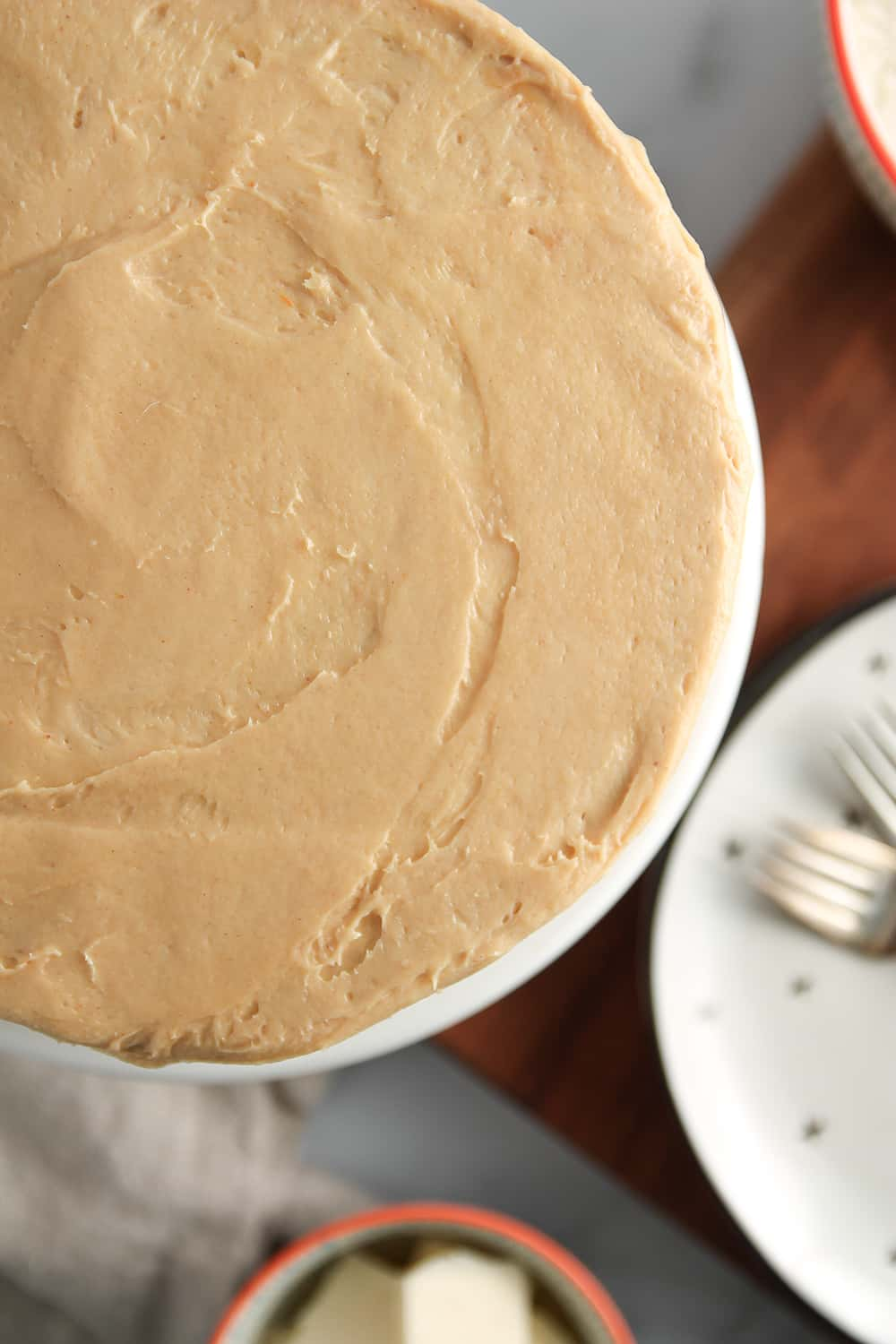Peanut butter cream cheese frosting is a tangy and sweet addition to Peanut Butter Cake