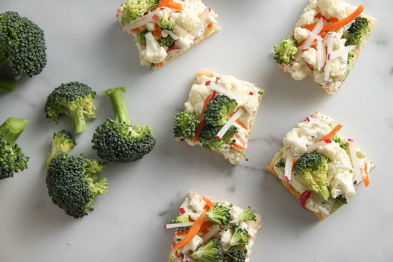 Crescent roll dough, ranch cream cheese and veggies combine to make delicious Vegetable Pizza.