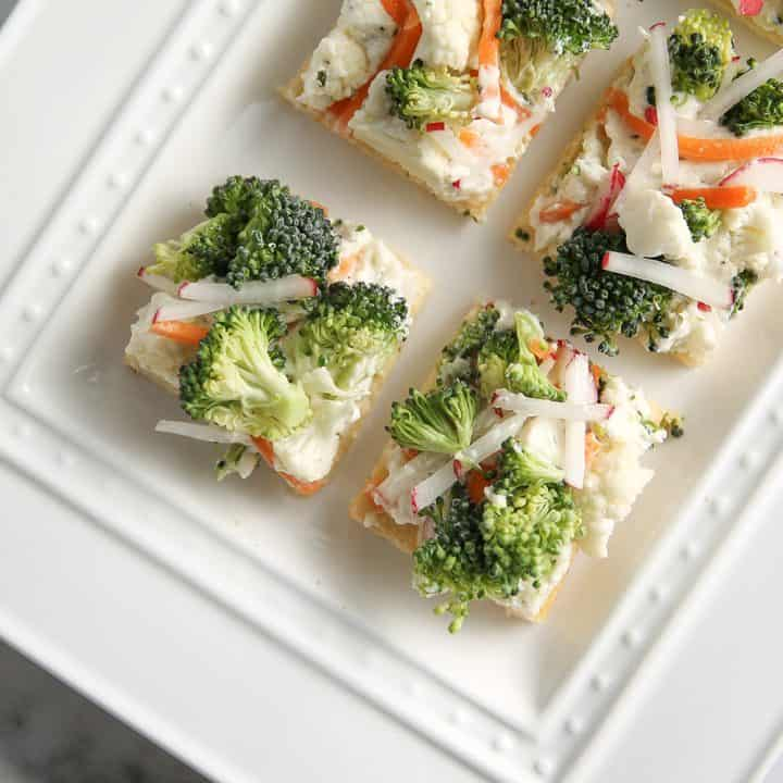 Vegetable Pizza is topped with ranch cream cheese and veggies for a great party appetizer