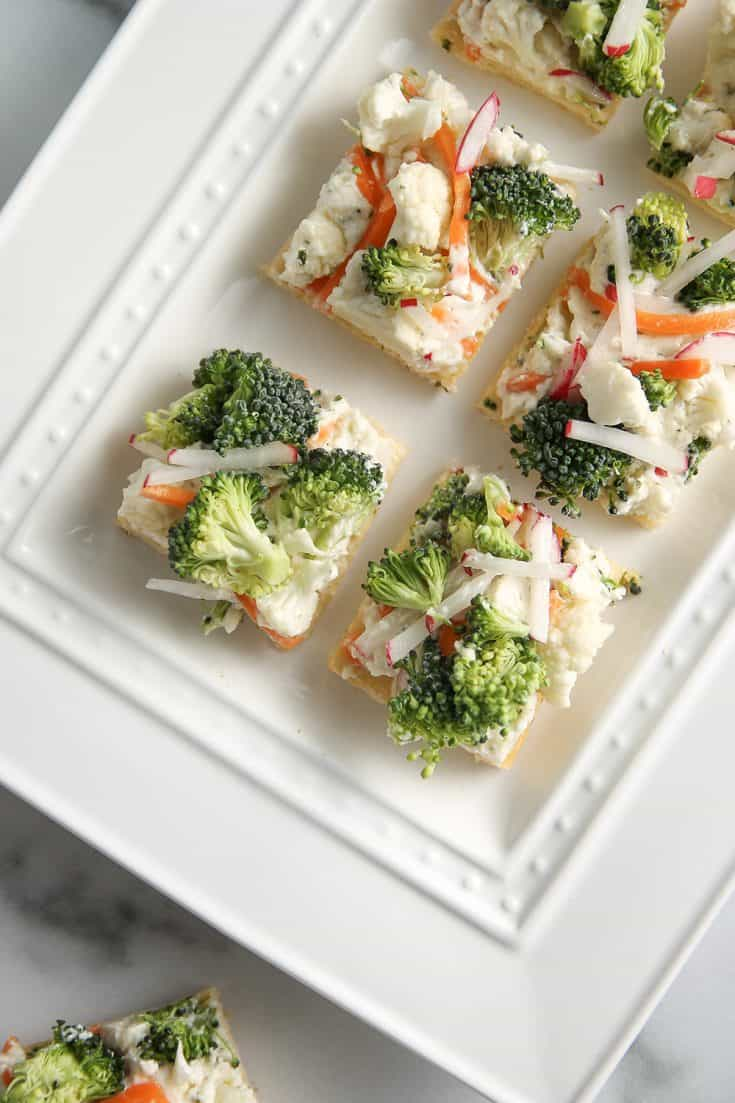 Made with a crescent roll crust and flavored with ranch dressing mix, Vegetable Pizza is a staple party appetizer in the Midwest!