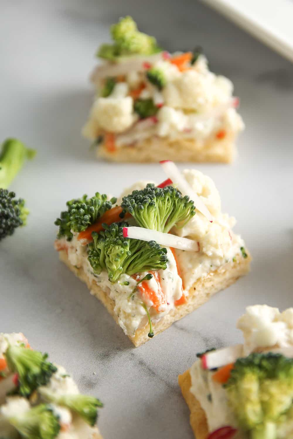 Vegetable Pizza is a delicious party appetizer, crescent roll dough topped with ranch cream cheese and chopped veggies.