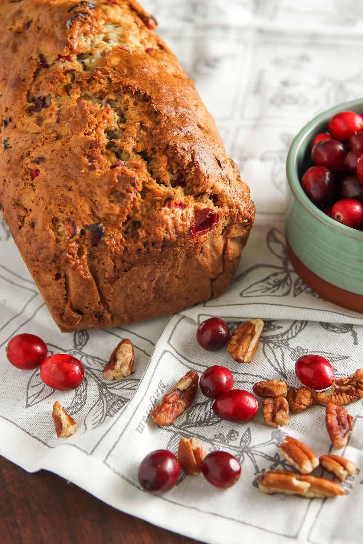 Cranberry Nut Bread is a delicious quick bread for the holiday season. Chock full of fresh cranberries and pecans, this is an easy quick bread you'll want to make again and again.