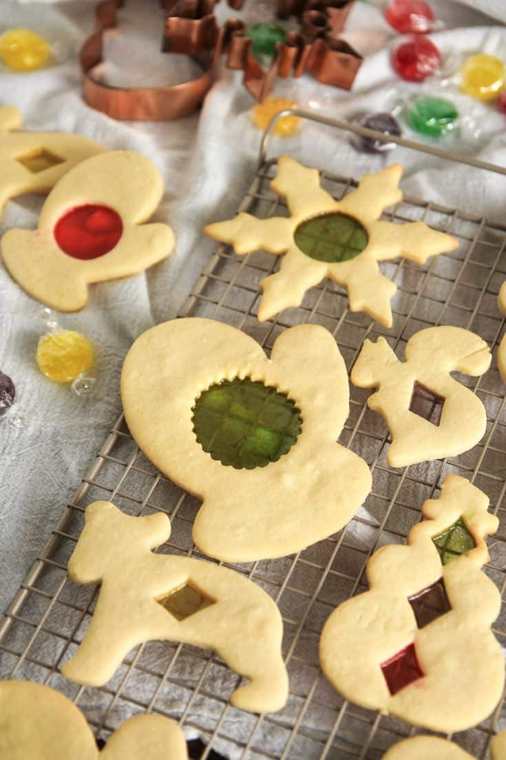 Stained Glass Cookies are a fun way to jazz up cut-out sugar cookies! Made with your favorite hard candies, these cookies are as fun to make as they are to eat.