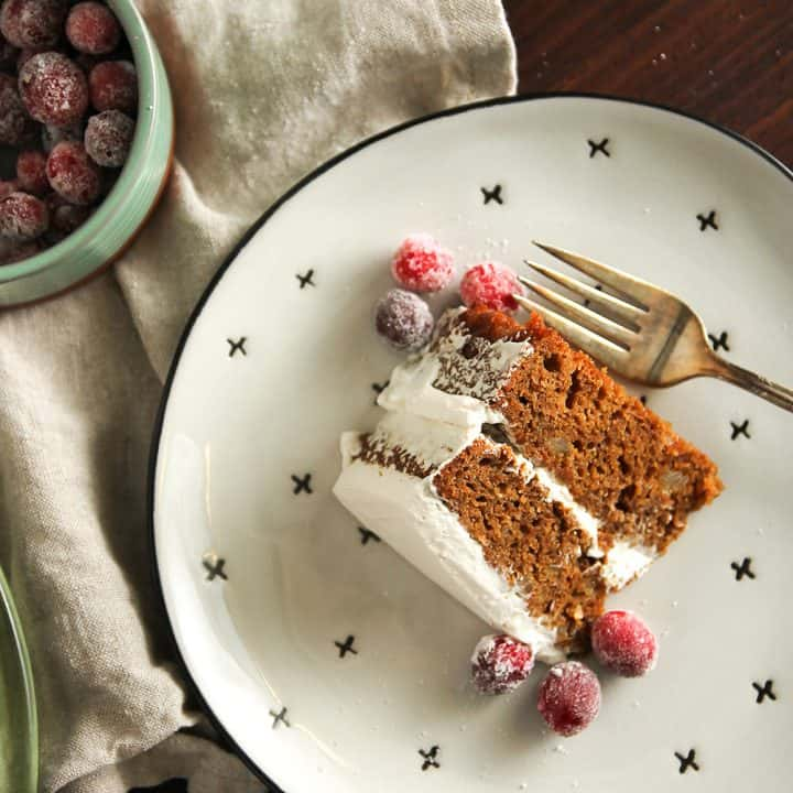 Gingerbread Layer Cake is garnished with sugared cranberries for a perfectly festive dessert