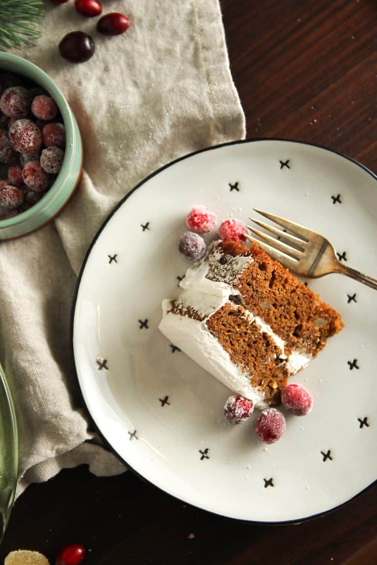 Gingerbread Layer Cake: Two layers of double gingerbread cake covered with whipped cream frosting and garnished with sugared cranberries. It's both delicious and beautifully festive, perfect for adorning your holiday table.