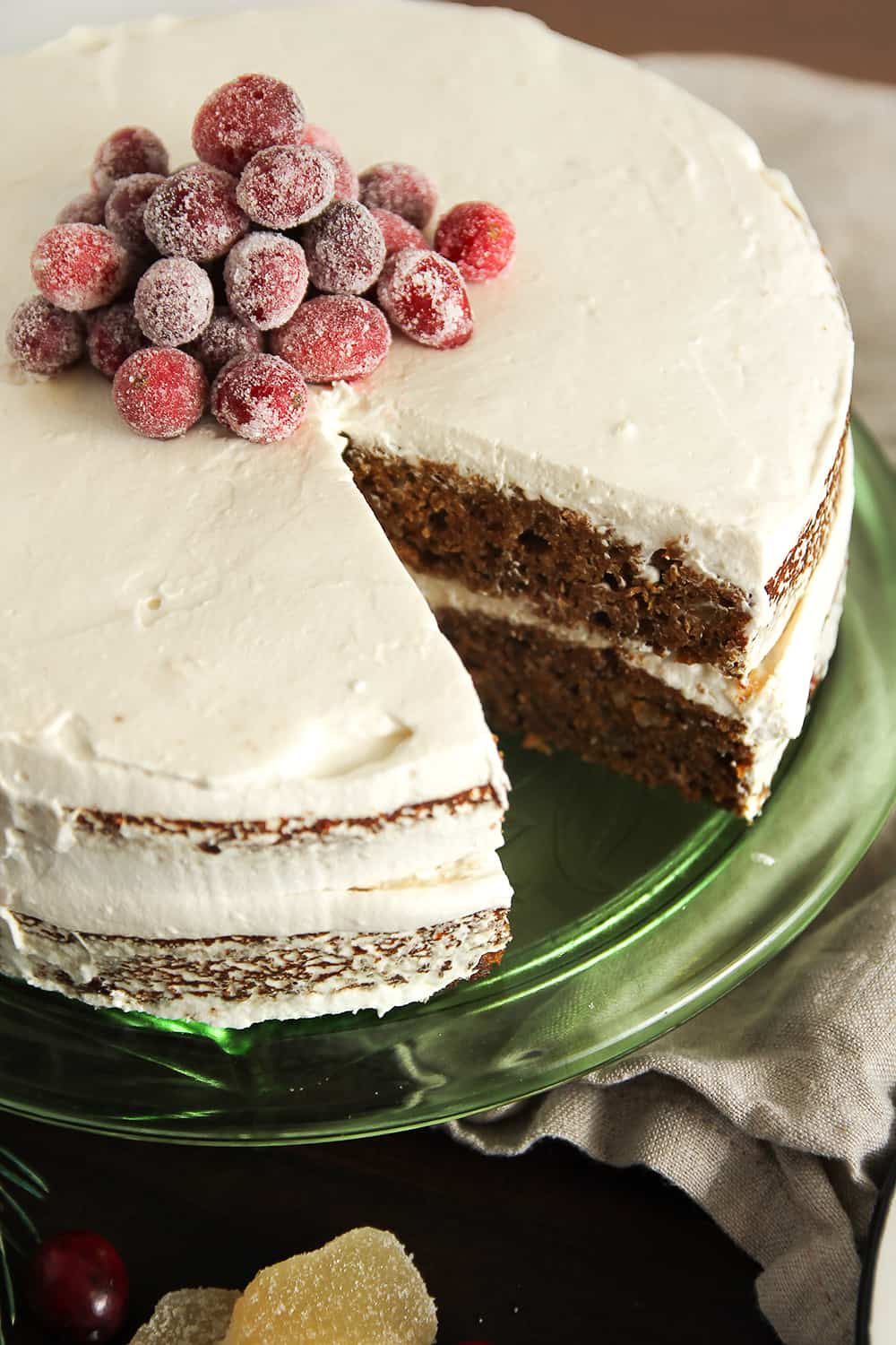 Gingerbread Layer Cake is two layers of gingerbread cake with whipped cream frosting and sugared cranberries