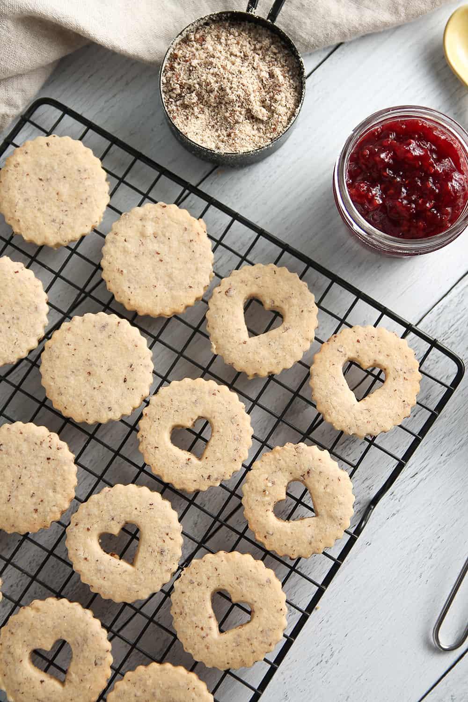 Raspberry Linzer Cookies sandwich raspberry jam between two almond cookies.