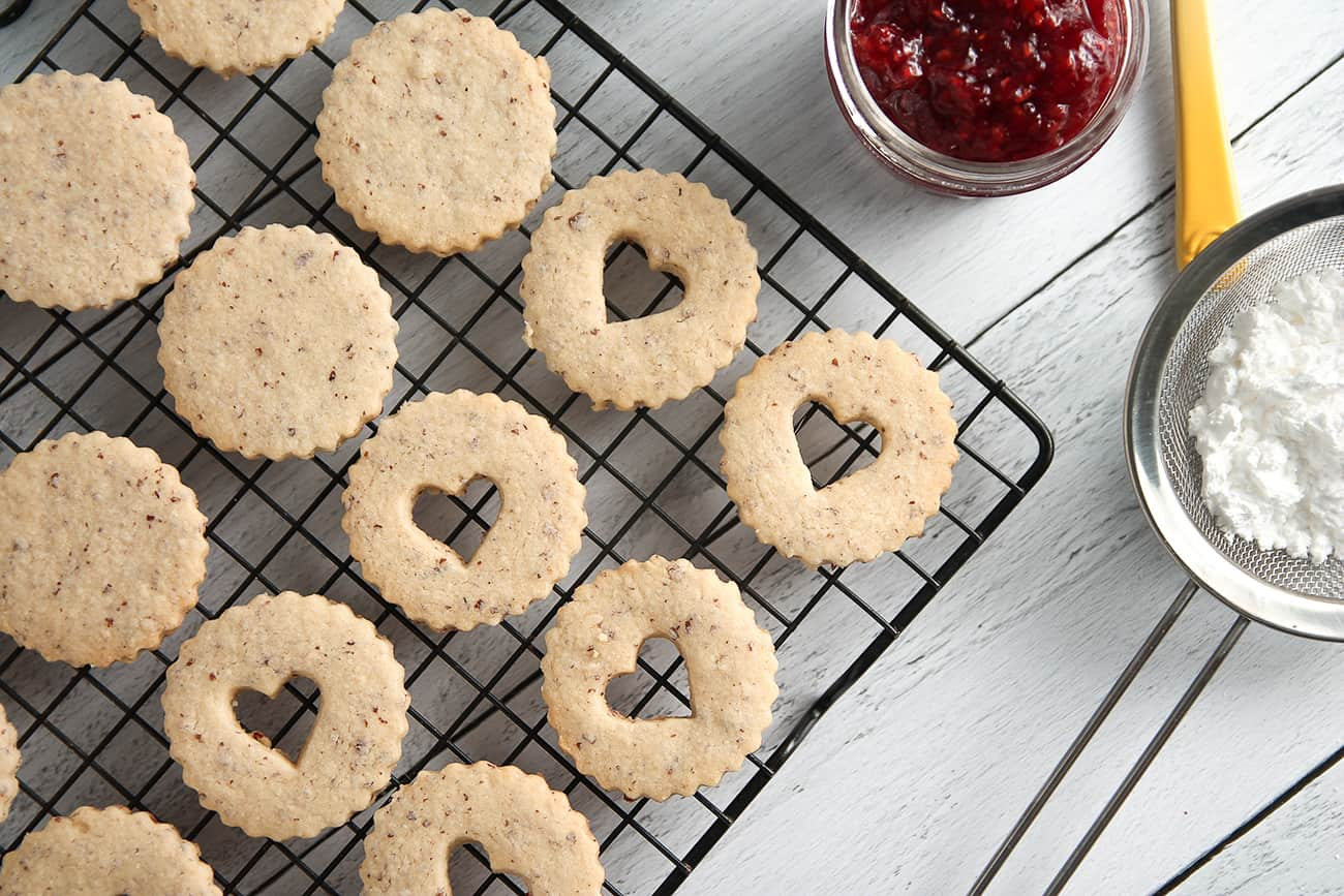 Raspberry Linzer Cookies are both bright and nutty with raspberry jam and almond cookies.
