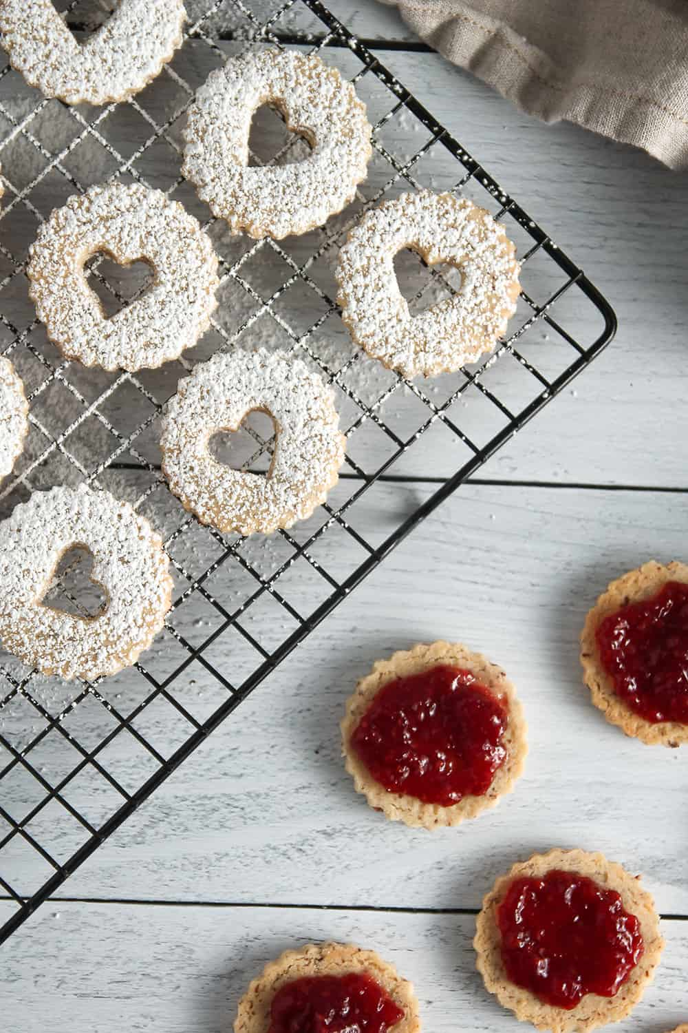 Raspberry Linzer Cookies are a sweet and beautiful way to celebrate Valentine's Day!
