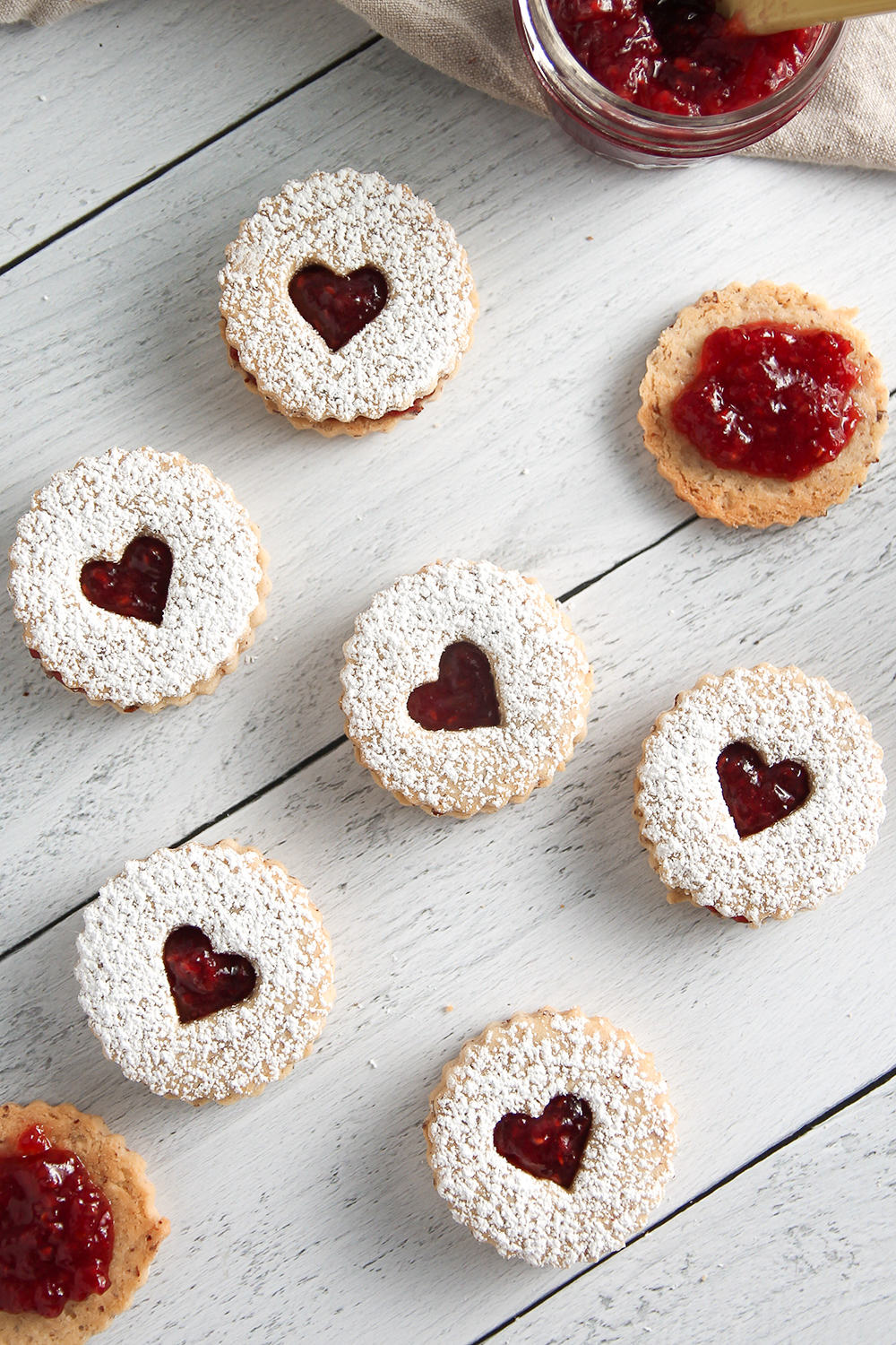 Tangy raspberry jam and nutty almonds come together to make sweet Raspberry Linzer Cookies.