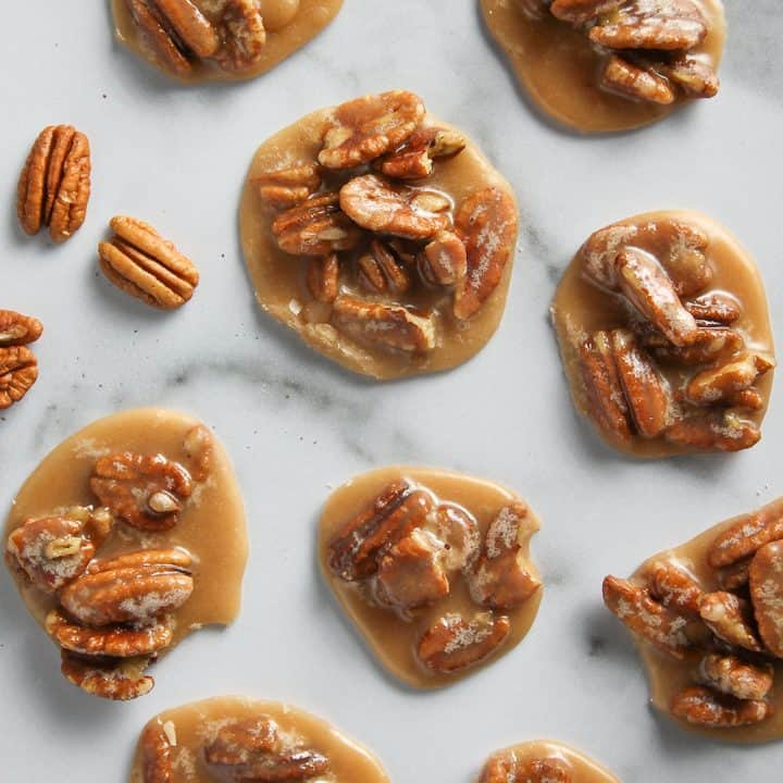 Sweet and creamy Pecan Pralines are a quintessential New Orleans treat. These pecan candies are easy to make and will make you feel like you're in the Big Easy.