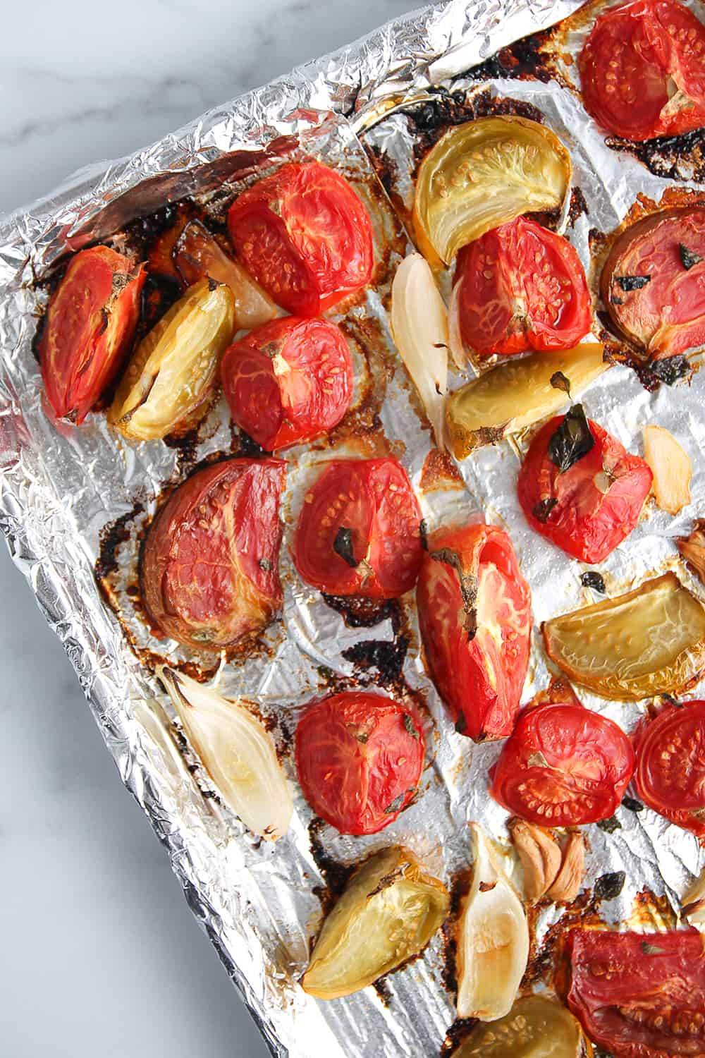 Roasted tomato sauce on a foiled-lined sheet pan
